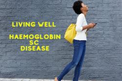 Slim african lady in blue jeans and white top and carrying a bright yellow shoulder bag - laughing - living well with Haemoglobin SC Disease