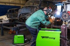 Man welding with Forney welding equipment