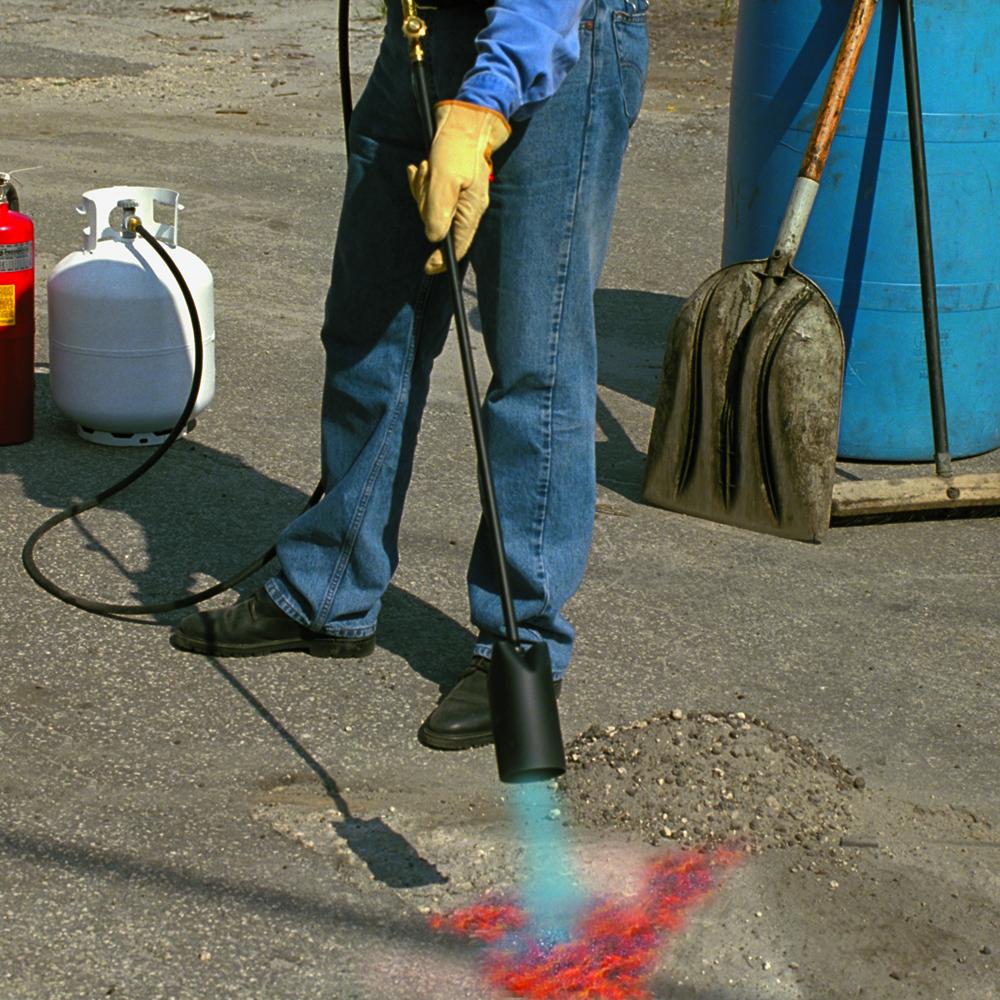 Forney Fireman Repairing Asphalt