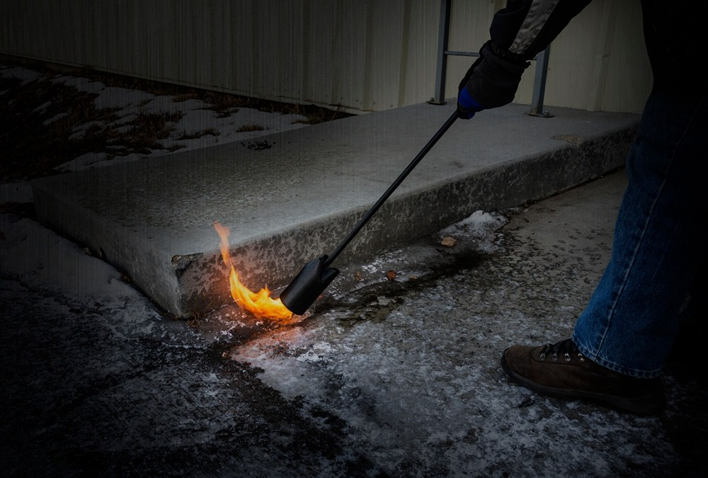 Melting Ice With A Flame Torch