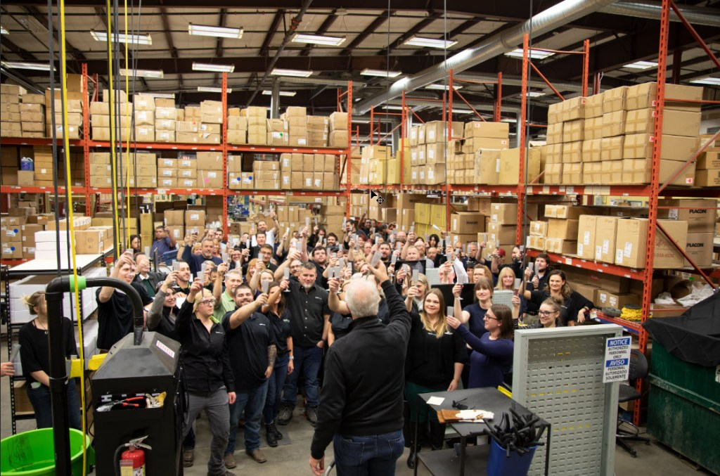 CEO and Employees Raise Their Glasses in Celebration