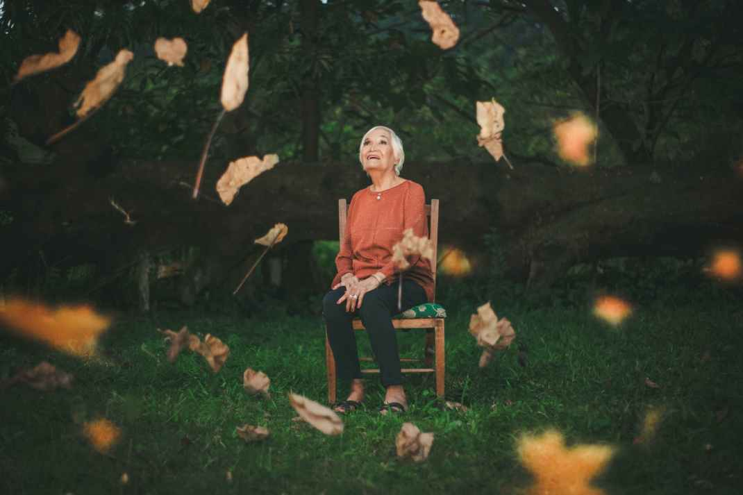 woman sitting on chair while looking upwards