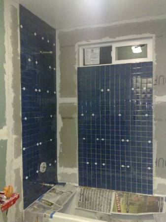 Lots of beautiful blue tile up now. Still have to buy the floor tile, though.