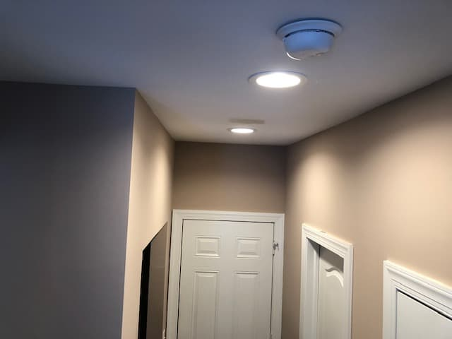 New can lights installed on the ceiling of a home
