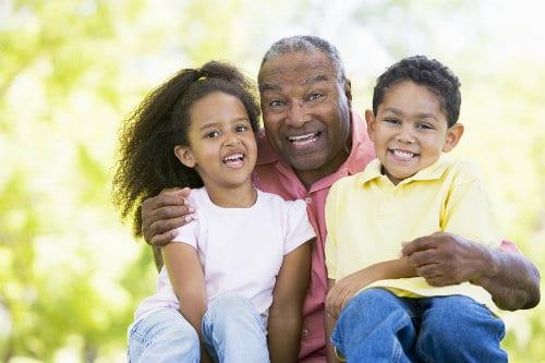 grandparent holding grandchildren