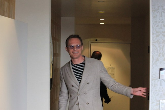Paul Bettany enters the room for our exclusive interview