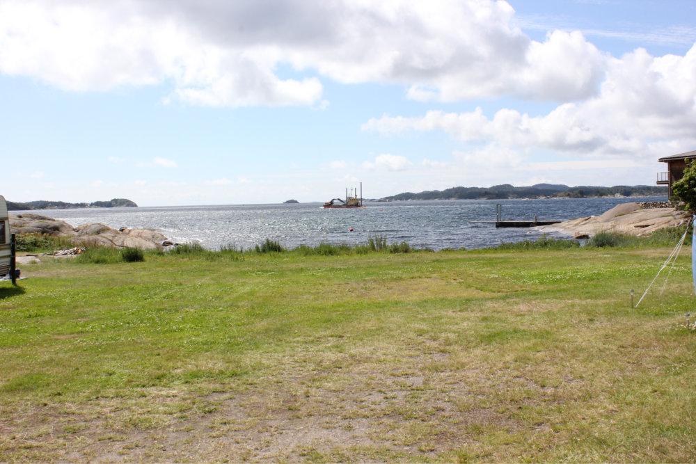 Bilde av strand og sjø
