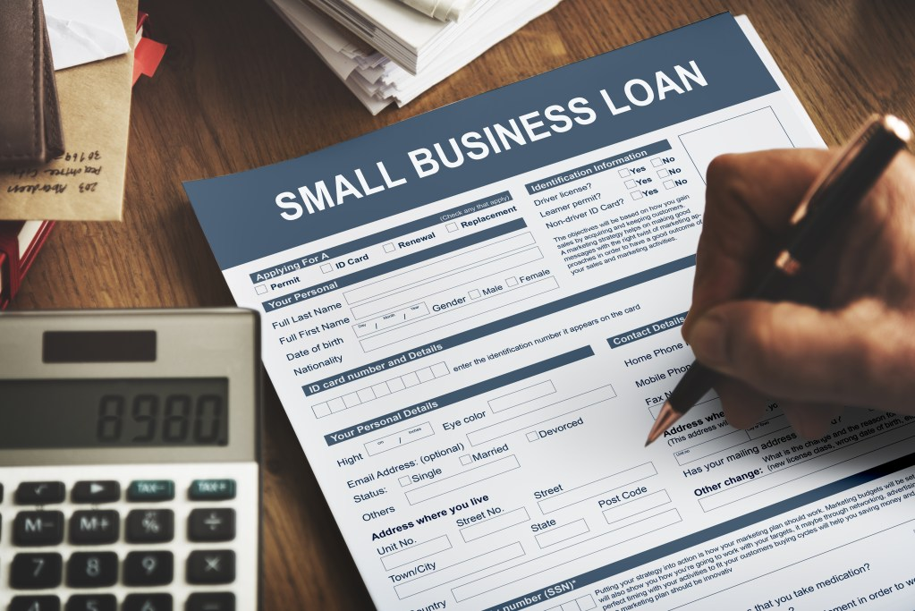 Filling out a small business loan.
