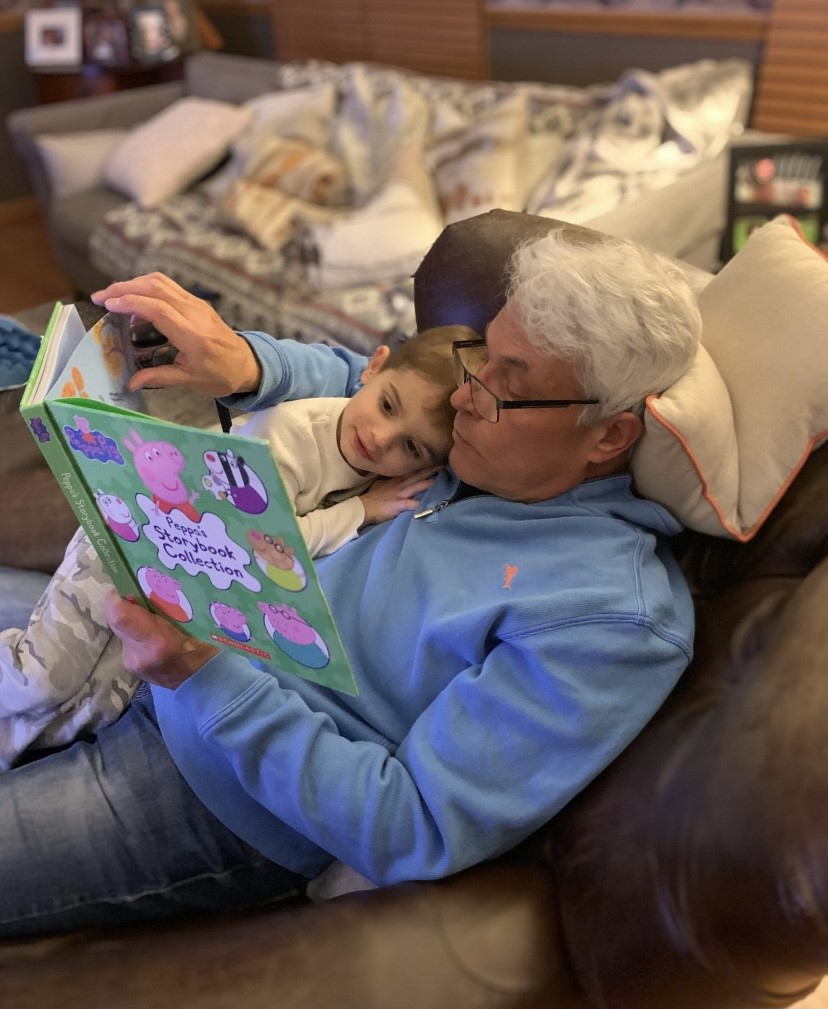 Ray reading a story to his grandchild