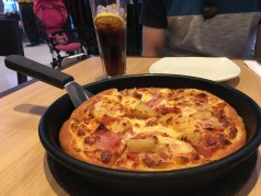 We found Hawaiian pizza at Pizza Hut. So yummy, but missing the tomato sauce...