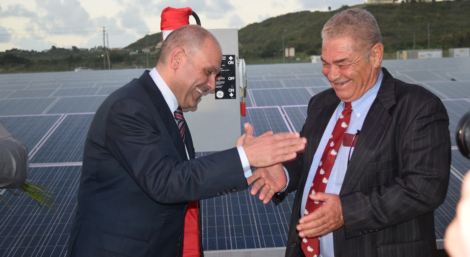 A jovial moment between Ministers of Energy and Public Utilities