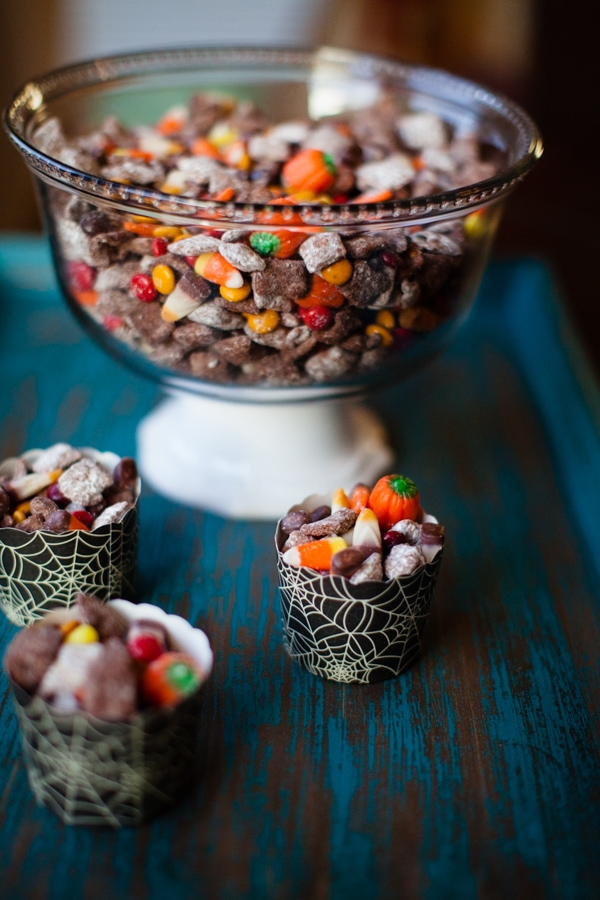 Nutella Puppy Chow -- this Nutella Chex Mix, Muddy Buddy, Puppy Chow is chock full of halloween candy and brownie mix and powdered sugar and it is the easiest and most delicious halloween treat you can imagine. You could sub any seasonal candies for the halloween ones for an any season treat | asouthernfairytale.com