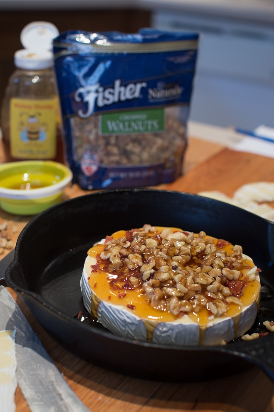 Honey Walnut Bacon topped Brie ready to go into the oven
