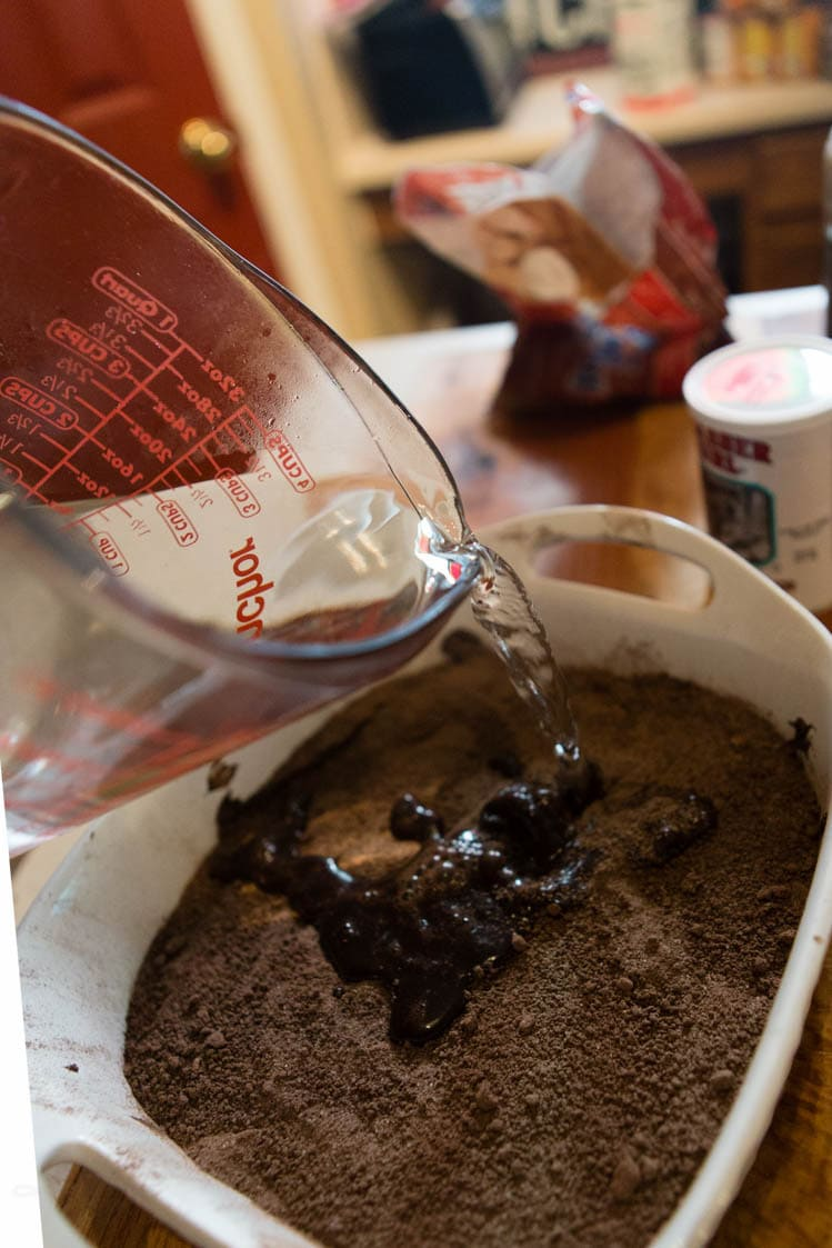 The chocolate cobbler gets topped off by a hot water bath before baking