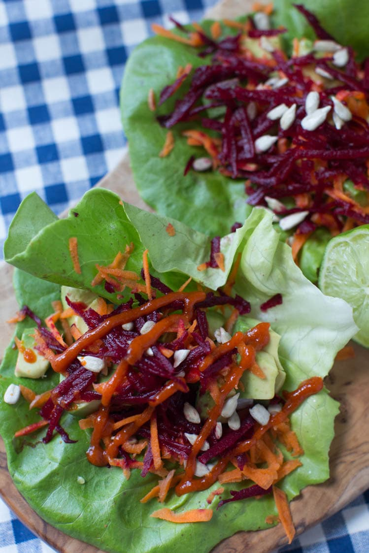 avocado, beet, and carrot salad wraps with sriracha