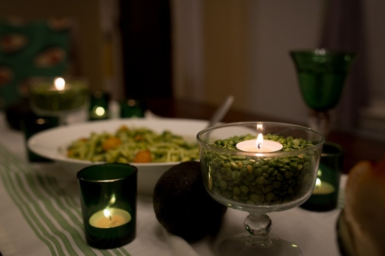 votive candles and dried split peas as table decorations for dinner en green