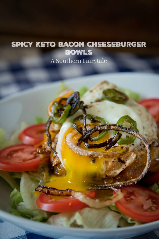 spicy keto bacon cheeseburger bowl with an over easy egg