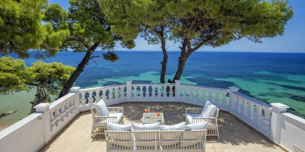 Image of the shaded furnished terrace with panoramic sea views of Villa Mandarin, located in Sithonia, Halkidiki.