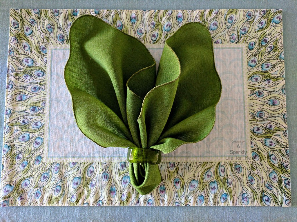 Watercolor Modern Peacock Place Mat with Green Leaf Napkin Fold by A Sparkly Life for Me