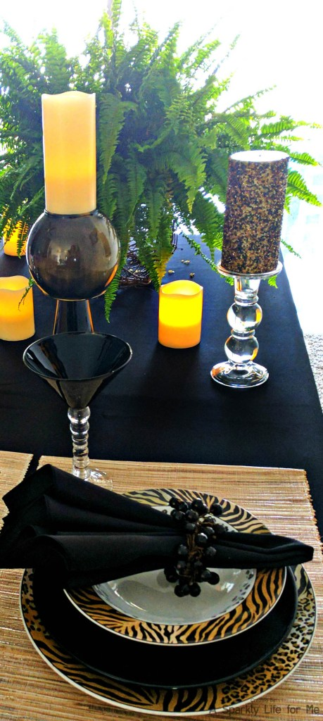 Fancy jungle and animal print table decor with DIY black and gold marble feature vase with LED candle accents table decor