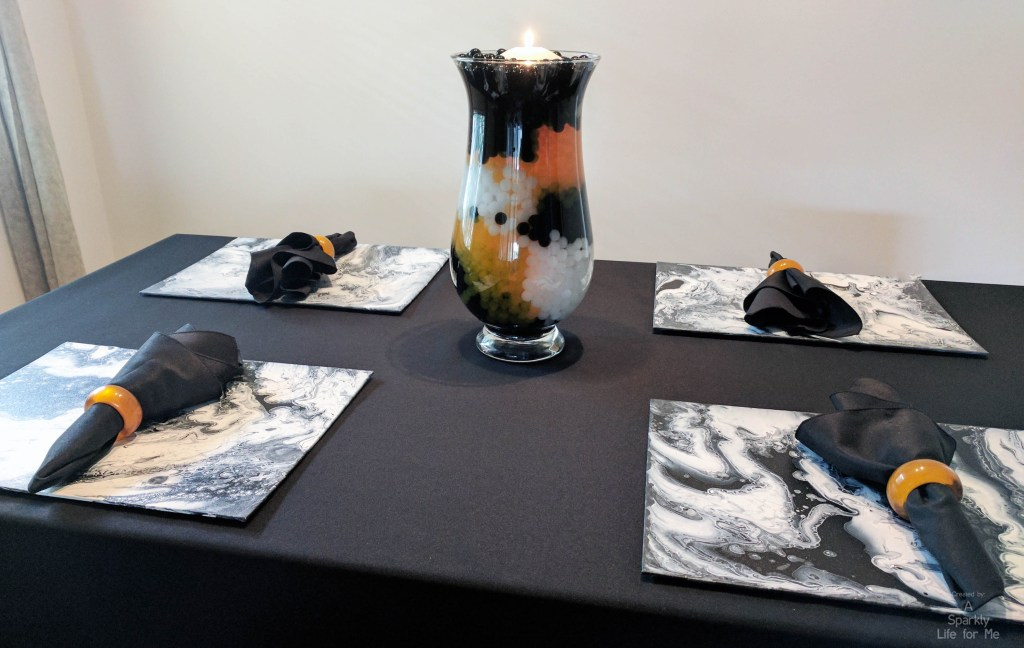 DIY fluid acrylic table decor for halloween in orange black and white by A Sparkly Life for Me