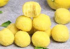 These Homemade Lemon Truffles are tangy, creamy and sweet. All you need is a few simple ingredients. After mixing the cake mix, sugar, butter, and lemon juice together, roll into small balls. Follow the recipe and the helpful video tutorial below!