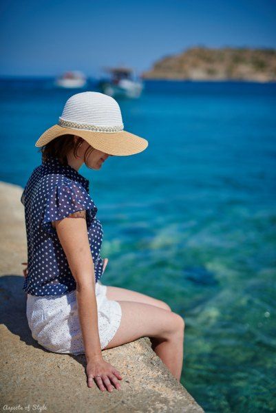 blue shirt, white shorts in Plaka, Crete