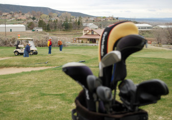 Golfers play the course at Battlement Mesa, a development originally created to house oil shale workers that found new life as a retirement community. Recently, oil and gas workers and residents seeking lower-cost housing have joined the mix, but the recession left many homes empty.