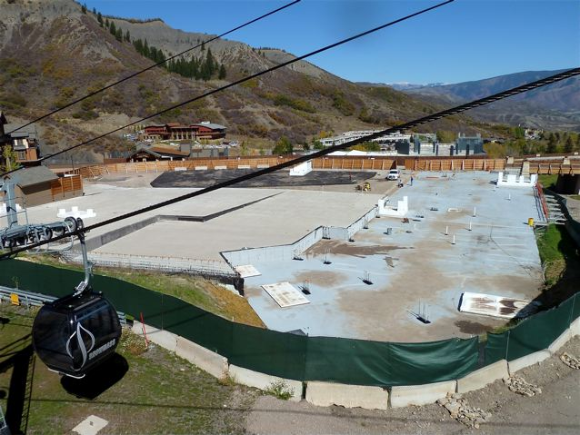 The concrete slab just downhill from the Elk Camp Gondola is the top of the Base Village parking garage.