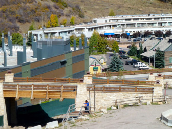 One of the bridges in Base Village that was built with proceeds from the sale of the metro district bonds. The green building in the background is the unfinished The Little Nell at Snowmass hotel. The gray flat building in the background is the Snowmass Center, which is still owned by the Related Cos.