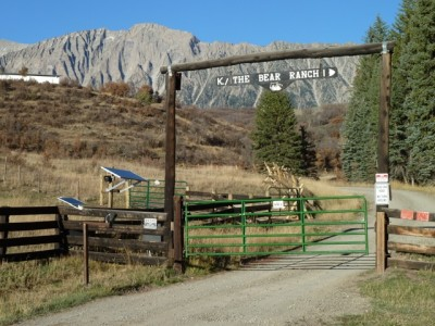 This the Bear Ranch gate at the end of County Road 2. Just before the gate, a road heads up and across BLM land between two parcels of Koch's private land.