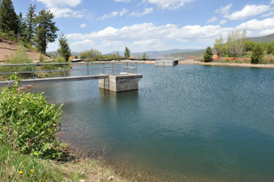 The city's Thomas Reservoir holds 10.3 acre-feet of water. The new outtake structure for the city's emergency drain line/penstock is visible on the far side of the reservoir.