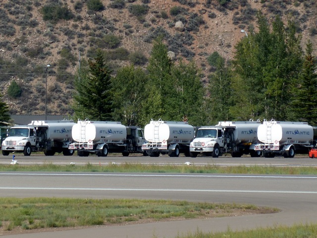 The fleet of general aviation fuel trucks at the Aspen airport. Atlantic Aviation, the fixed based operator in Aspen, sells about 3 million gallons each year.