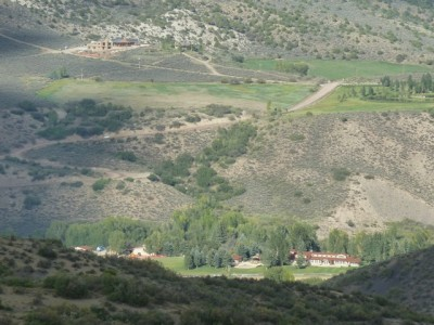 A portion of the High Mesa Ranch, where the new horse barn is under construction. That's Watson Divide Road in the background, across Snowmass Creek.