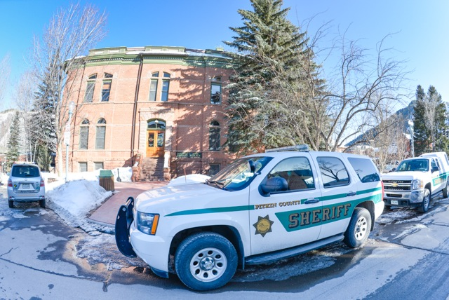 Pitkin County sheriff and Aspen police vehicles on the west side of the Pitkin County courthouse on March 5, 2013.