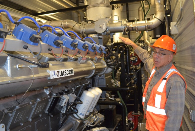 Julian Huzyk, COO of Vessels Coal Gas, describes the workings of a generator, essentially an oversized diesel truck engine with 16 cylinders and 1500 horsepower, where methane is converted into electricity at the Elk Creek Mine in Somerset, Colo.