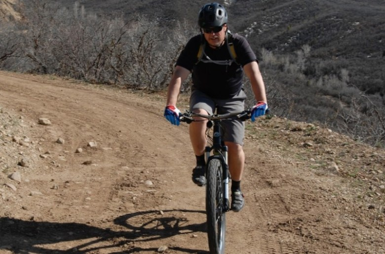 Local land-use planning consultant Tom Stevens rode his mountain bike up a dirt road in The Crown area near Carbondale on April 11. Lingering snow and mud have kept most bikers off the area to date.