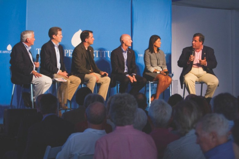 A panel of GOP governors, moderated by Walter Isaacson, far left, on July 24, 2014. The panel included, from left, Gov. Sam Brownback of Kansas, Gov. Scott Walker of Wisconsin, Gov. Rick Scott of Florida, Gov. Nikki Haley of S. Carolina, and Gov. Chris Christie of New Jersey, far right.