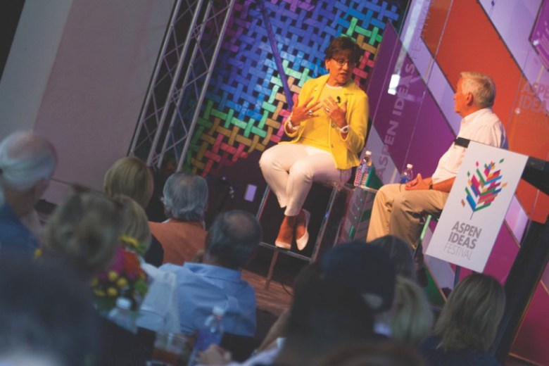 Penny Pritzker, left, talks with Walter Isaacson at the Aspen Ideas Festival, July 3, 2014.