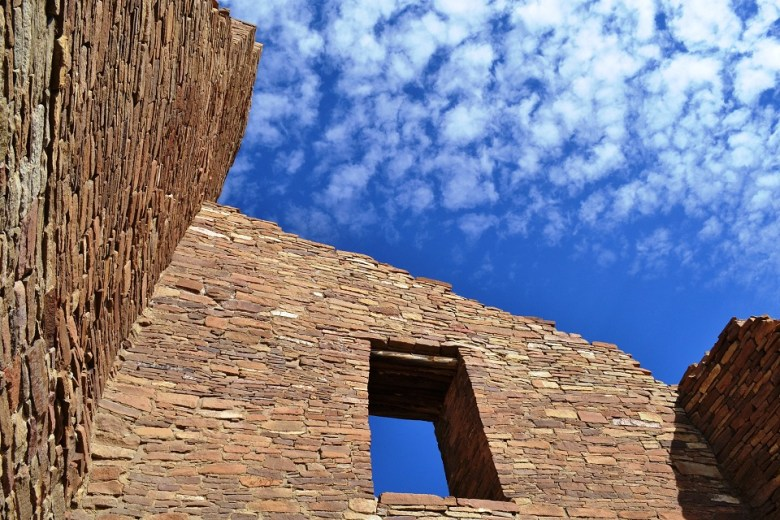 The stone walls of the Chaco Canyon great houses are marvels of ancient construction, rising several stories into the blue desert skies.