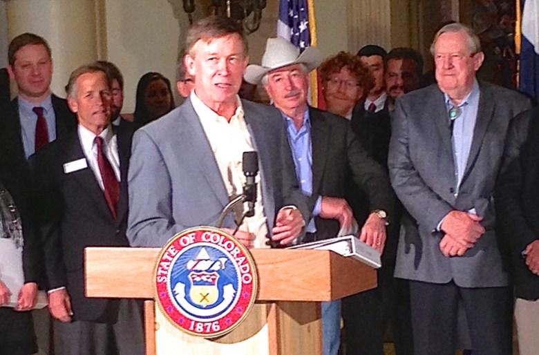 Gov. Hickenlooper accepting the first draft of the Colorado Water Plan on Dec. 10, 2014 at the Colorado statehouse.