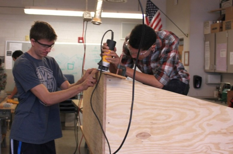 Students Cullen White (left) and Leo Anguiano work together to finish a cold-frame box in the Basalt High School woodshop.