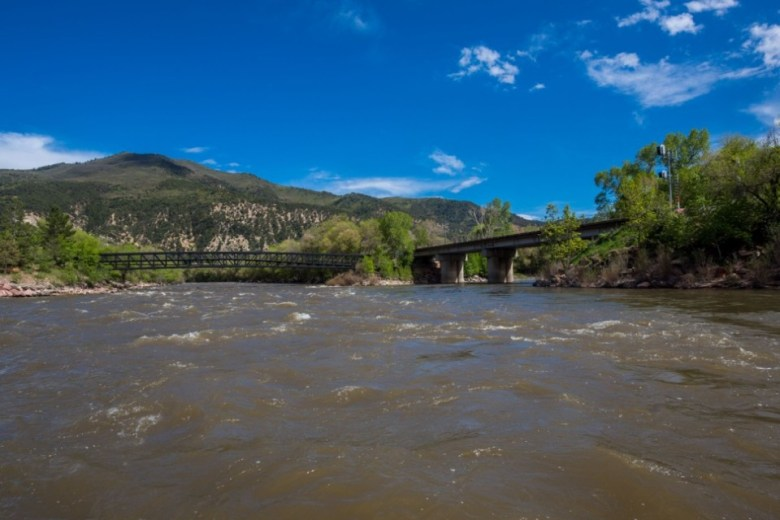 Looking up the Colorado River, left, toward the confluence of the Colorado and the Roaring Fork River, right. The bridge over the Colorado is a pedestrian bridge. The bridge over the Fork is a railroad bridge.