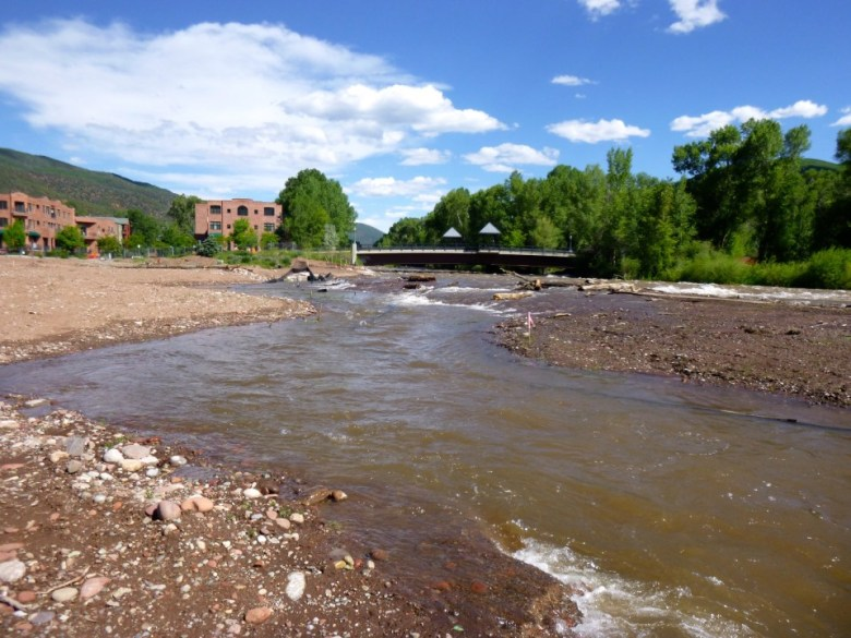 The floodplain on the former site of the Pan and Fork trailer park was evident on Wednesday morning, as the Roaring Fork River overtopped - by design - new rock work installed along the river.