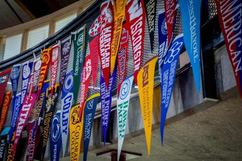 The college banners hanging in the Aspen High School commons go up when a student is accepted there. It's a broad cross-section of American colleges and universities: big and small, urban and rural, east and west and in between.