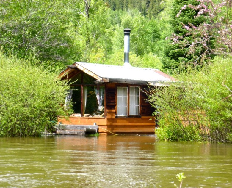 This cabin along the Roaring Fork River in the Stillwater section of the Roaring Fork RIver has taken on some of the week's high water. According to Edgar Boyles, who lives upstream, the cabin was built in 1965 by Charlie Bolte, who Boyles described as a hermit, philosopher and iconoclast.