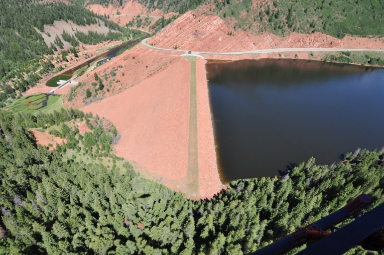 The crest of the dam across the Fryingpan River that forms Ruedi Reservoir, which can hold 102,373 acre-feet of water.