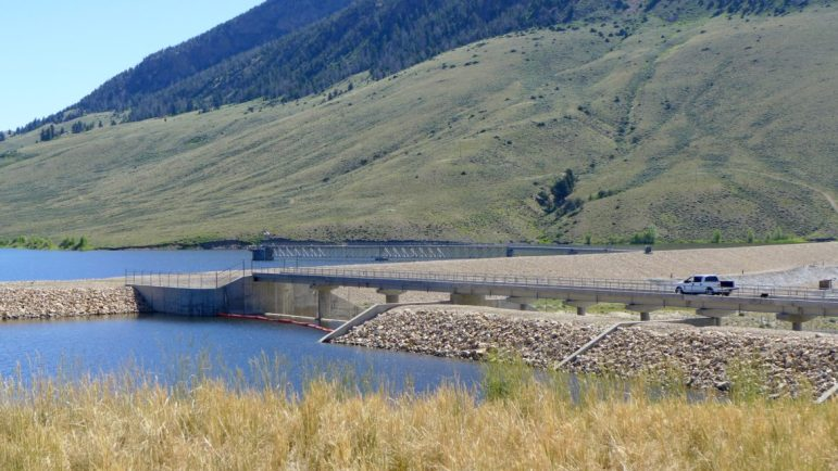 A truck drives out to Ritschard Dam, which forms Wolford Reservoir, on July 13, 2016. The dam has settled two feet downward and moved eight inches horizontally since being built in 1995.