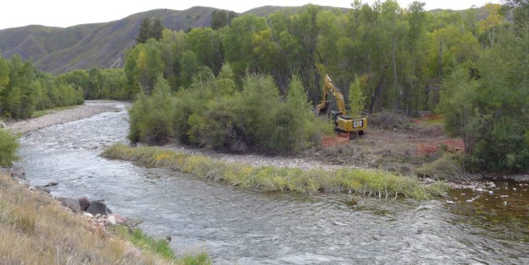 An excavator working on the bypass channel for the whitewater park in the Roaring Fork River in Basalt, on Sept. 12, 2016. Work in the channel itself is expected to begin soon.
