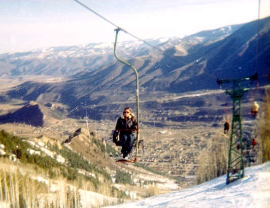 A skier riding up Lift One on April 11, 1971 (Easter Sunday), the last day for Lift One before it was replaced by Lift 1 A. Truly, the end on an era and a turning point from old Aspen to new Aspen.